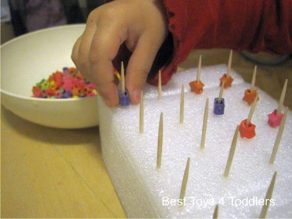 threading star beads on toothpicks