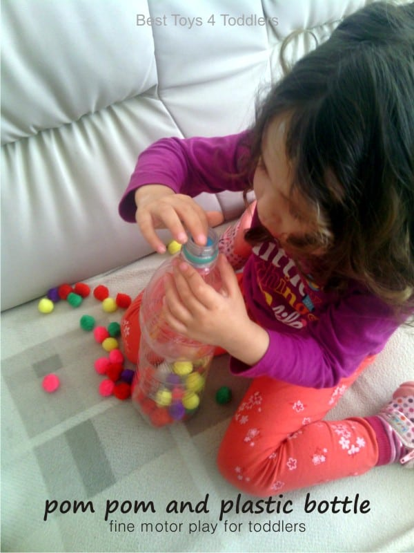 Fine Motor Play with Pom Poms and Plastic Bottle, easy #junkplay idea for toddlers