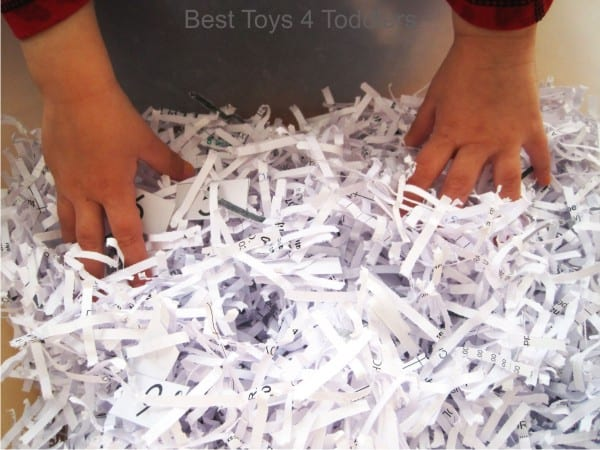 Tactile sensory bin with number 1-10 scavenger hunt