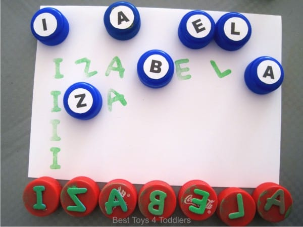 Matching letters of the name with bottle caps, name recognition learning with toddlers and preschoolers