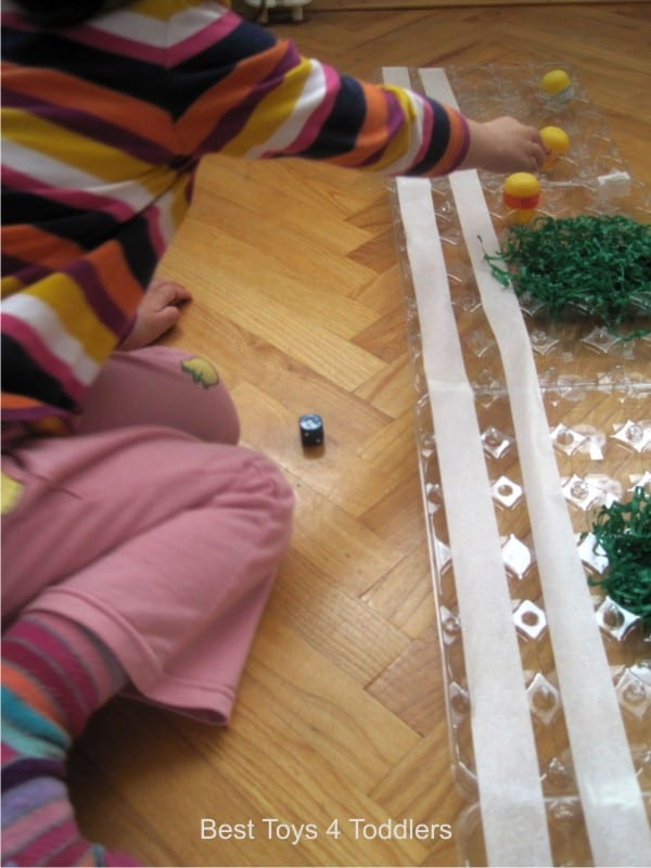 Learning to take turns with homemade Egg Racing board game