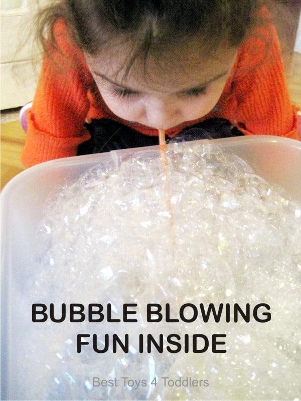 Bubble Blowing Fun Inside, playing with bubbles in a sensory bin