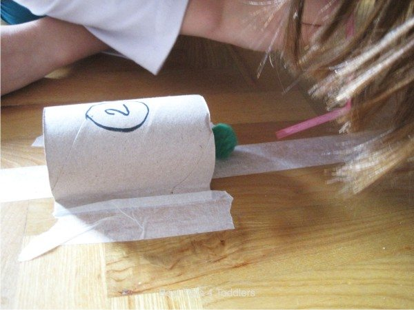 Easy toilet paper roll tunnels and fun blowing and racing pom poms