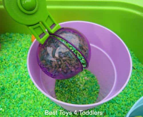 Scooping and other fine motor skill ideas to use with toddlers as they explore apple scented rice
