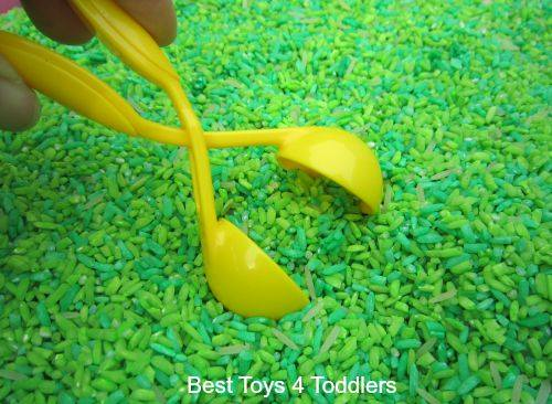 Fine motor skill practice for toddlers and preschoolers with apple scented rice.