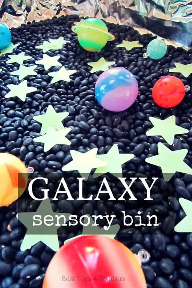 Amazing, glowing and fun galaxy sensory bin for all little space, stars, moon and planet lovers! #sensorybin #spacetheme #sensoryplay #playideas