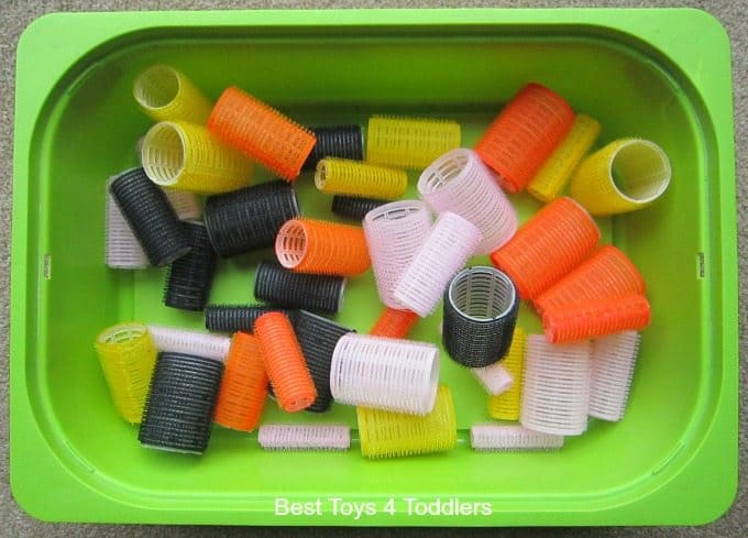 Hair rollers sensory bin