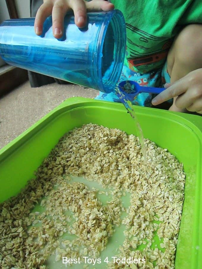 Adding water to oats toddler play activity
