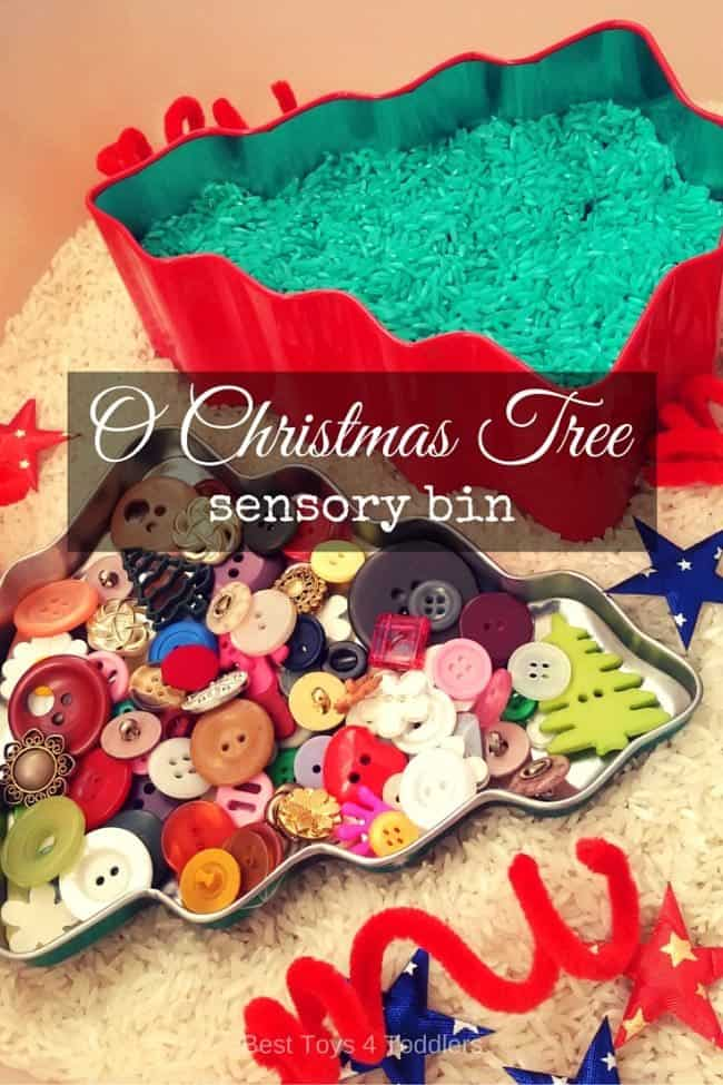 Simple sensory bin to explore with toddlers as they sing O Christmas Tree carol using white and green rice as base with ornaments, jingle bells, buttons and more