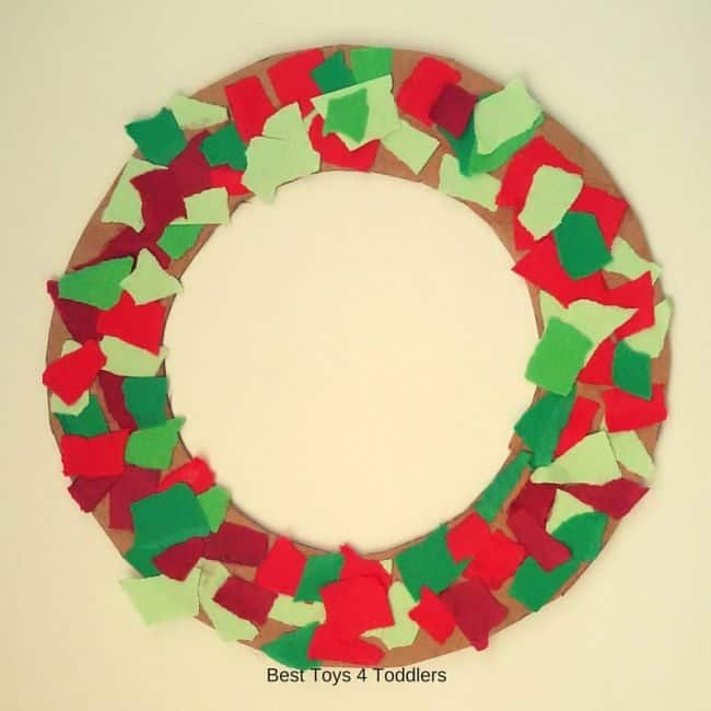 Christmas wreath from paper scraps created by toddler.