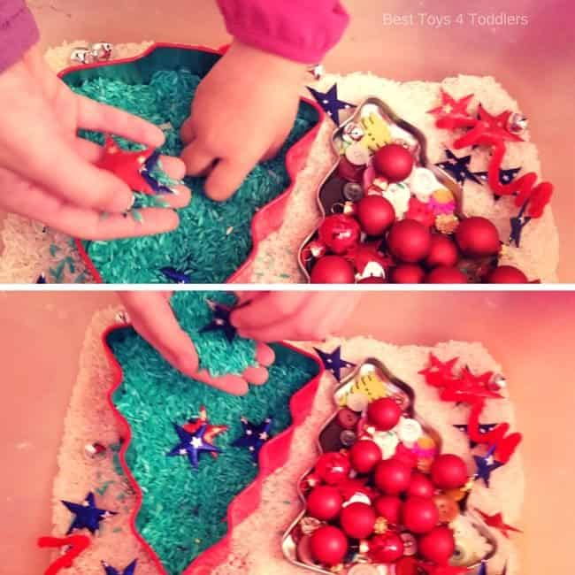 searching through mini Christmas tree sensory bin for ornaments and other hidden objects