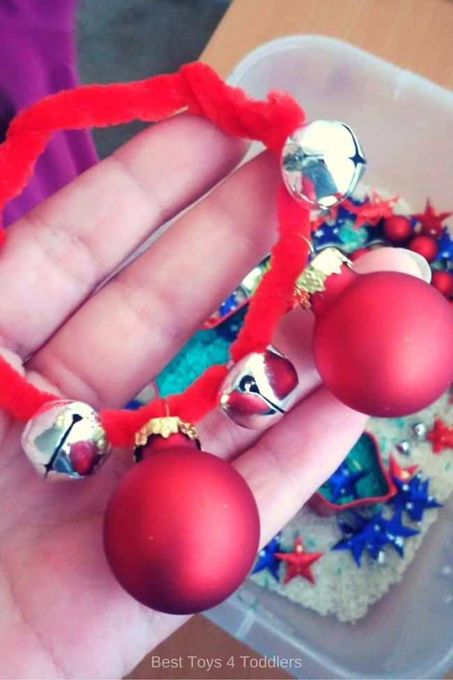 Creating bracelets with pipe cleaners, jingle bells and tiny Christmas ornaments