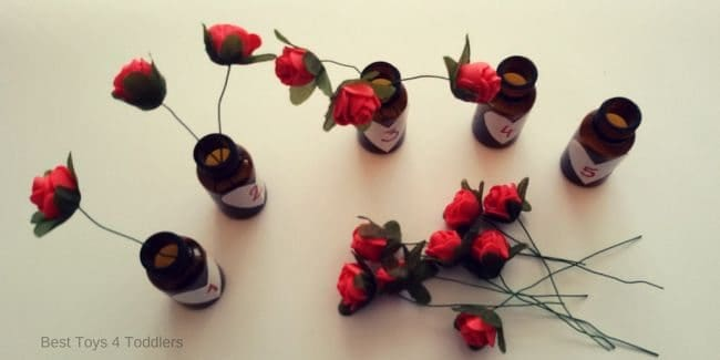 prepare 5 mini bottles and 15 mini roses to learn counting numbers 1-5