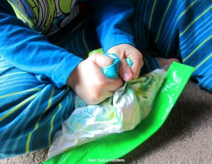 Squishing a sensory bag
