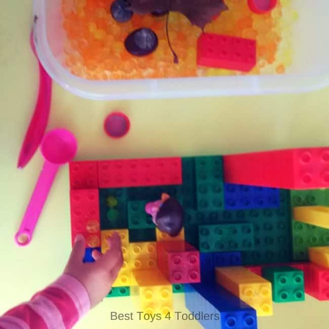 Child led exploration - adding Lego Duplo sturcture and additional manipulatives into sensory play.