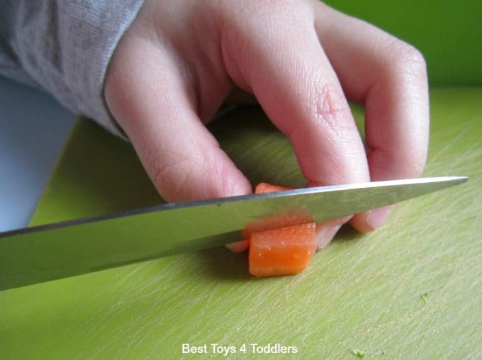 Toddler using a knife