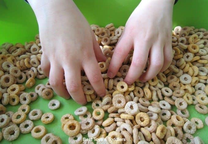 Exploring a cereal sensory bin