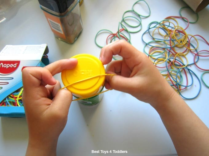 Elastic band fine motor play activity