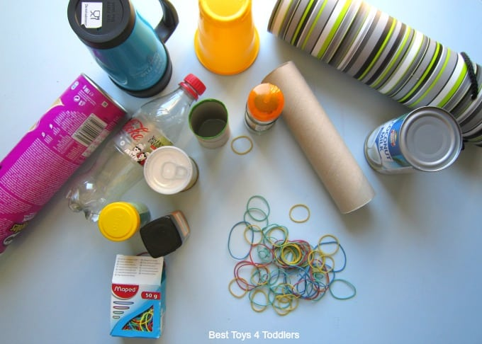 Rubber band fine motor play using household items