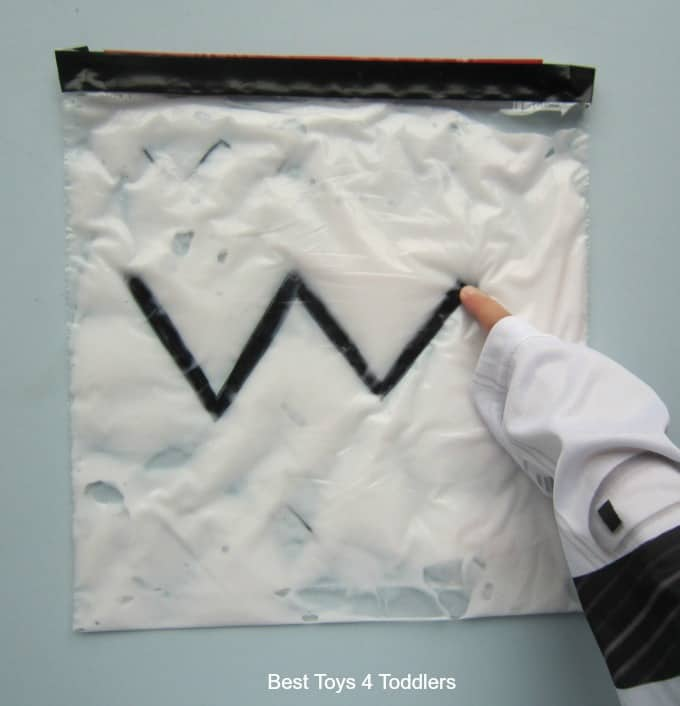 working on forming zig zag lines with sensory play