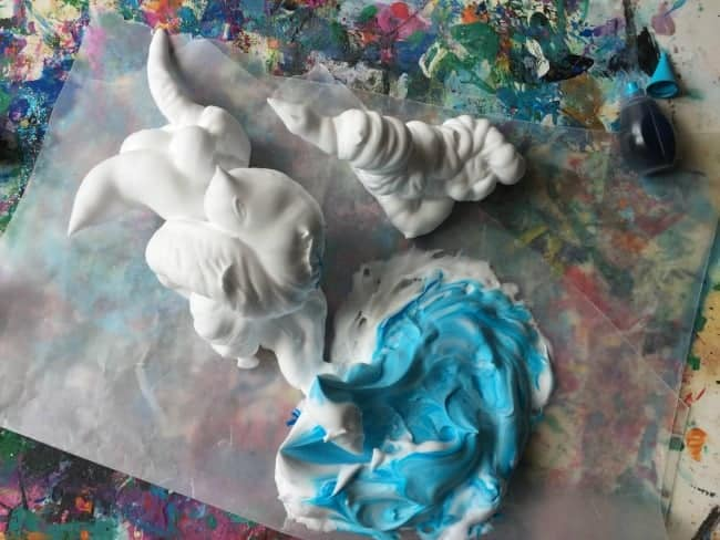 mixing coloring agent into shaving cream