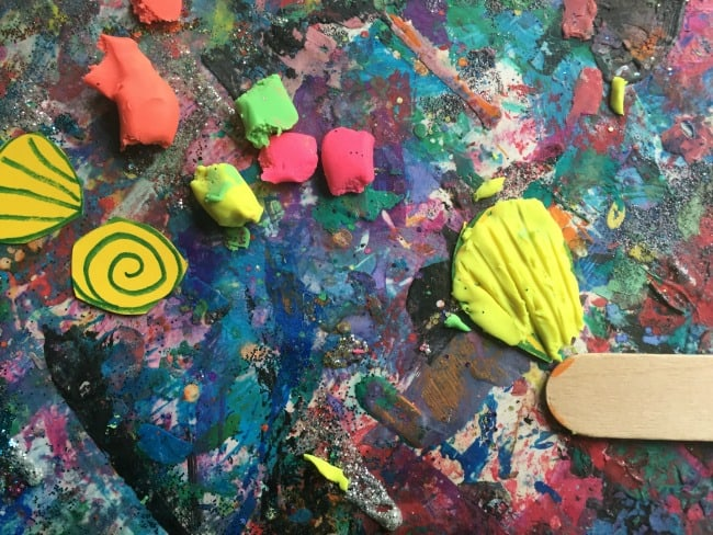 Creating clay shells for summer themed sensory bag