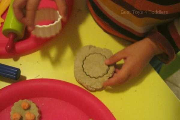working with cookie cutters and playdough requires precision and concentration
