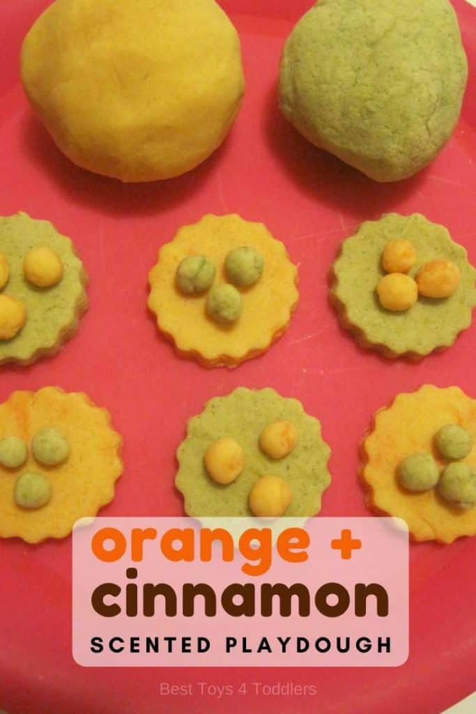 Homemade orange and cinnamon scented playdough recipe for sensory and pretend play in kid's kitchen. #sensoryplay #pretendplay #scentedplaydough #playdoughrecipe #recipeforplay #playideas #finemotorskills #besttoys4tots