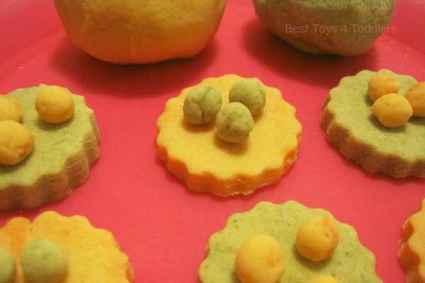 pretend play with an orange and cinnamon scented cookies with homemade no-cooked playdough