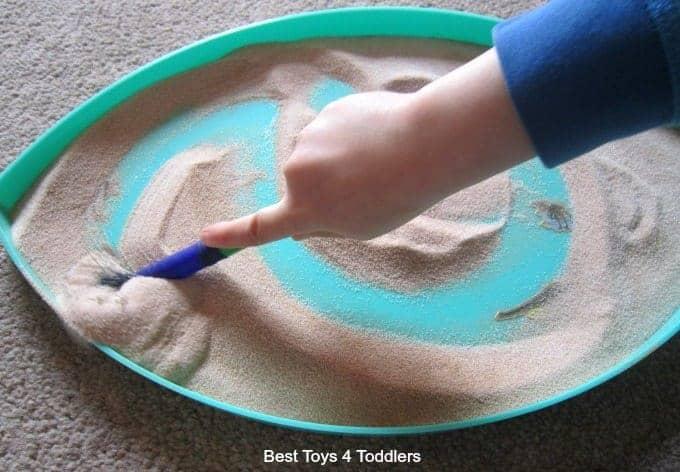 Dinosaur salt tray for fine motor practice