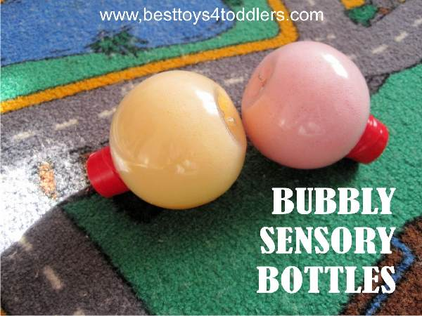 playing with sensory bottles filled with bath bubbles